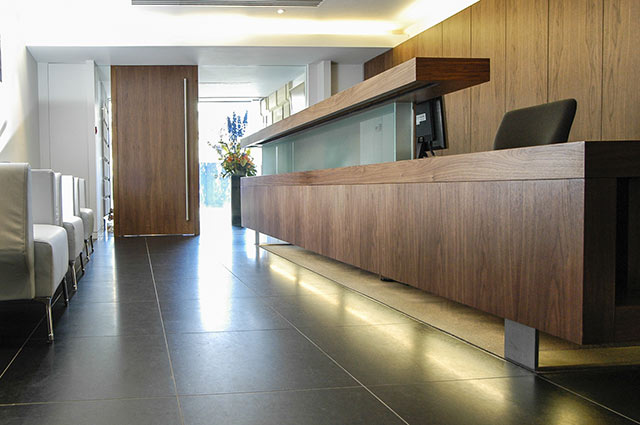 Bank reception area with bespoke counter and storage units