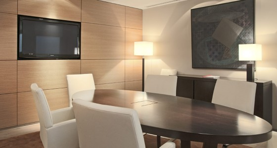 Bespoke boardroom fit-out with wall paneling and table